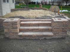 Steps Raised Patio with bench seat along house