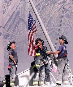 """I read about the man raising the flag in this pic who was a firefighter in NYC on 9/11 seriously incredible book """"The Long Run"""""""