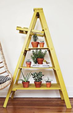 Ladder Display Makeover Turn an old ladder into a cool bookshelf. Once I move into a bigger space, I am totally doing this.Turn an old ladder into a cool bookshelf. Once I move into a bigger space, I am totally doing this. Ladder Display, Ladder Bookshelf, Cool Bookshelves, Diy Ladder, Ladder Decor, Display Shelves, Plant Shelves, Old Ladder Shelf, Plant Ladder