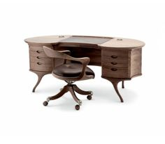 The Bean desk from Ceccotti - Collezioni. An astounding amount of craftsmanship hours goes into making this striking and unique desk.