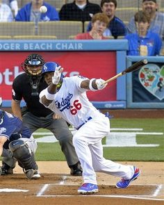 Los Angeles Dodgers' Yasiel Puig hits a single during the 1st inning of their baseball game against the San Diego Padres, Monday, June 3, 2013, in Los Angeles. (AP Photo/Mark J. Terrill)
