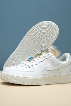 """All flash with the substance to match, this Women's Nike Air Force 1 Low """"Bling"""" is the latest look to incorporate jewels into its design. And it doesn't stop there. Buttery white tumbled leather appears on both the Swoosh and back heel tab, as well. Air Force Ones, Air Force 1, Nike Air Force, Air Force Jordans, White Leather, Kicks, Sneakers Nike, Bling, Fit"""