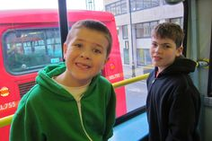 The kids riding a double-decker bus in London.