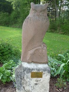Eagle Owl carved out of wood - seen in the Park in Bad Woerishofen, Bavaria