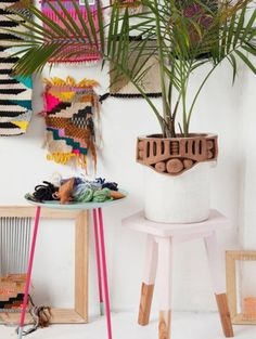 Image from interiors mag - ELLE Decoration. A mix of woven, macrame, brights and neutrals, alongside wood and plant life. Has a tribal, ethnical feel.