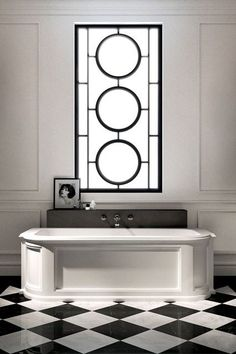 Art Deco inspired black and white design bathroom with a striking bathroom window featuring a frosted and black design.