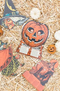 vintage Halloween games on a hay bale.