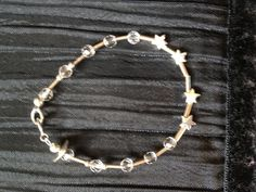 A totally gorgeous christening bracelet in sterling silver, with stars and quartz beads. £16