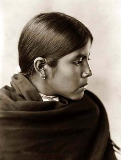 You are viewing an important image of a Qahatika Indian Girl. It was taken in 1907 by Edward S. Curtis.    The picture shows a wonderful portrait of this young lady.    We have created this collection of pictures primarily to serve as an easy to access educational tool. Contact curator@old-picture.com.    Image ID# FEEF4E83