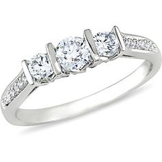 Yea, right, like this is EVER going to happen - 1/2 Carat T.W. Three-Stone Diamond Engagement Ring in 10kt White Gold