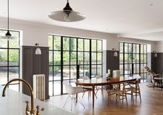 The dining area with Crittal-style steel-framed windows. - The dining area with Crittal-style steel-framed windows. Arts And Crafts Interiors, Arts And Crafts House, Home Crafts, Orangerie Extension, Crittal Doors, Crittall Windows, Open Plan Kitchen Living Room, Home Decoracion, London House