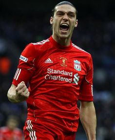 AC Milan are considering a loan move for Liverpool's Andy Carroll.