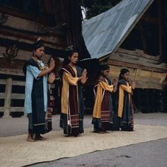 Toba Batak people performing a traditional dance, wearing ulos