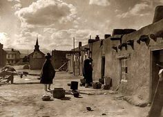 Here for your consideration is an artistic picture of a Street Scene in San Juan New Mexico. It was created in 1927 by Edward S. Curtis. The picture presents Indians of North America in San Juan. We have created this collection of illustrations primarily to serve as a valuable educational tool. Contact curator@old-picture.com.