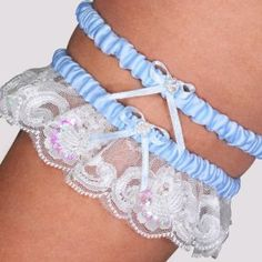 "Wedding Favors Beaded Lace Wedding Garter in Blue by Cathysconcepts. $23.30. Wedding Favor - Bridal Shower Gift - Baby Shower Keepsake: Let our Beaded Lace Wedding Garter in Blue be your fabulous finishing touch. Fashioned in crisp satin, complimented by lace and decorated with bows and rows of iridescent beads, this wedding accessory has ""bridal"" written all over it. Doubling as your ideal ""something blue,"" this garter combines a fun sense of whimsy this age old bridal t..."