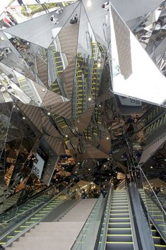 "Tokyu Plaza Omotesando Harajuku by Hiroshi Nakamura- ""The entrance is an impressive seizure-inducing kaleidoscope of mirrors that's akin to something out of Stargate."""