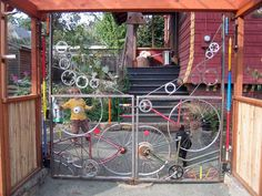 Portland, OR: A custom gate, hinges and all, re-use bicycle technology, built for the owner of Clever Cycles. Garden Gates And Fencing, Fence Gate, Gates And Railings, Custom Gates, Recycled Garden, Bamboo Fence, Bicycle Art, Chickens Backyard, Garden Art