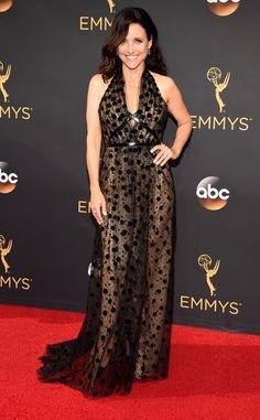 2016 Emmys: Julia Louis-Dreyfus is wearing a black sheer Swiss dot Carolina Herrera halter gown. Classy and sophisticated!