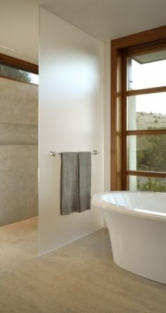 Love the frosted glass wall in this curbless shower. Also the clerestory and the tall window. For more practical application, it can be narrower and possibly textured