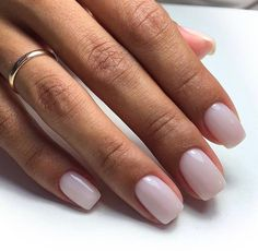 "If you're unfamiliar with nail trends and you hear the words ""coffin nails,"" what comes to mind? It's not nails with coffins drawn on them. It's long nails with a square tip, and the look has. Neutral Nails, Nude Nails, Gel Nails, Nail Polish, Short Pink Nails, Yellow Nails, Milky Nails, Nagel Blog, Gel Nail Colors"