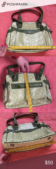 Coach handbag Coach handbag, green and white. Preloved but very clean. A small ink stain on the inside. Some fading along the edges on the top of the bag, seen closer in pic 3 and 5. Coach Bags Shoulder Bags