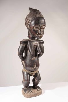 Statue Maternité africaine baoulé en ligne dans la galerie www.Arts-Ethniques.com pour tout contact : eop@art-africain.com