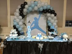 Michael Jordan baby shower cake table. These are not decorations you buy at the store. Mom and my sister worked together and got a lot of these things custom made or did them by hand.