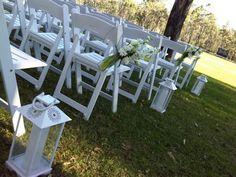 #whitefoldingchairs #weddingceremony #lanterns #freshflowers