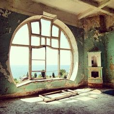 "Beautiful Art Deco ""rising moon"" Window  More About Us: http://krigarealestate.com. It's so sad there are so many abandoned places with such stunning architecture & craftsmanship.  Plus in this case, look at that view!!"