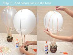 balão feito com bexiga, cestinha e fitas