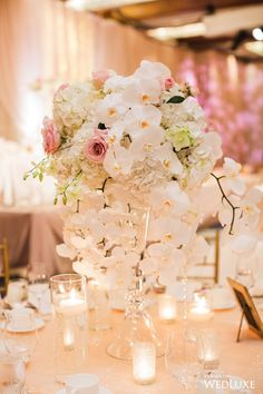 This centrepiece is just so pretty | WedLuxe  #Centrepiece #Florals #Pink #White #Orchids #Reception #Decor #TableDecor