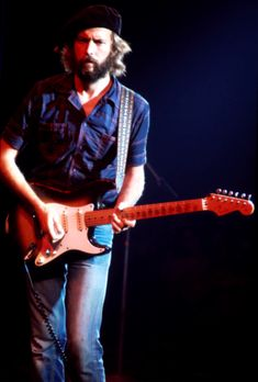 British guitarist Eric Clapton performing on stage during his US tour in 1975. (Photo by Michael Putland/Getty Images) via @AOL_Lifestyle Read more: https://www.aol.com/article/entertainment/2018/01/12/eric-clapton-reveals-he-is-going-deaf-after-tinnitus-diagnosis/23332398/?a_dgi=aolshare_pinterest#fullscreen