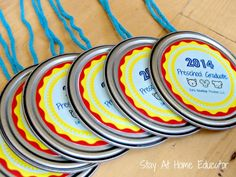 Preschool graduation medals made from frozen juice lids - Stay At Home Educator