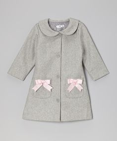 This charming coat will look smartly sweet on any little lady. Featuring a mod cut thanks to a Peter Pan collar, single-breasted buttons and dainty bows on the double pockets, this lovely lined layer is one genius style choice.