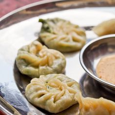 #Spinach and cheese momos - Bite sized Nepalese delicacies. Flavor explosion in your mouth! A must try in Nepal, or make your own at home. #appetizer