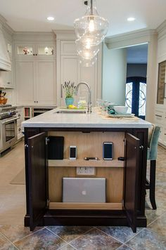 Smart Kitchen Charging Stations and Drawers to Always Stay Connected Cabinet at the end of the kitchen island acts as the charging station [From: behold design / Forte in Focus Photography] Smart Kitchen, Kitchen Redo, Home Decor Kitchen, Kitchen And Bath, Home Kitchens, Kitchen Dining, Kitchen Ideas, Rustic Kitchen, Kitchen Designs