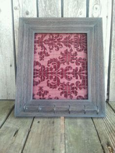 A great idea for jewelry, using a coordinating fabric and old wood frame.