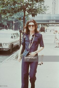 Jacqueline Kennedy Onassis walking down the streets of New York; circa 1970; New York.