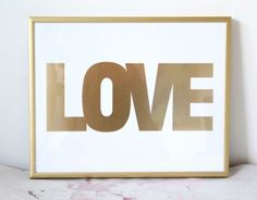 Made with a metallic gold look on white paper. This Love print will definitely be the highlight of your home. Totally chic & can also fit in most bookcases as part of the decor! Printed on 100lb bright white paper. The frame in this photo is the Gold Metal frame.