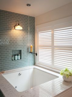 Deep bathtub. Water from the ceiling. Blue tile. Beautiful window. Would love to have a bathroom like that! Take a few minutes to relax and soak in some luxurious bathrooms designed by the experts at DIY Network and HGTV.