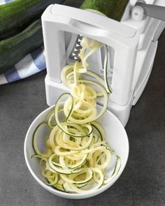 """Spiralizer 5-Blade Vegetable Chopper  This handy crank-and-slicemachinecan churn out delicate squash ribbons, perfectly portioned onion rounds, crunchy radish wheels, and hearty strings of beet spaghetti faster than you can say """"zoodle."""" Taking the Whol"""