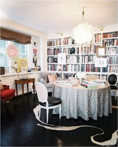 dine in library- round table, built ins under window