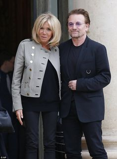 French First Lady Brigitte Macron met with U2 front man Bono at the Elysee Palace on Monday for talks on poverty