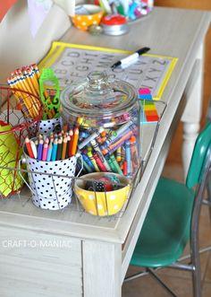 Control the overflow of kid's art and craft supplies. Via Craft-O-Maniac: Kids Art & Homework Station