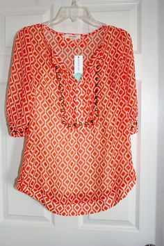 I rec'd this top in blue/mint, but I love this shade of orange and the print!