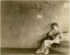 Grace Godwin, proprietor of a tea room at 58 Washington Square South, NY, plays guitar while her cat naps. Photo by Jessie Tarbox Beals. Greenwich Village, Jessie, Best Guitar Players, Washington Square, New York, First Humans, Famous Photographers, World's Fair, Music Theory
