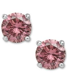 Perfection in pink. These sparkling stud earrings feature round-cut treated pink diamonds ct.) in a four-prong setting of white gold. PLEASE NOTE: A pair Pink Diamond Earrings, 14k White Gold Earrings, Diamond Jewelry, Diamond Stud, Stud Earrings, Pink Jewelry, Women's Jewelry, Bridal Jewelry, White Gold Diamonds