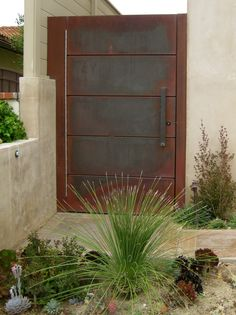 Here is a contemporary or transitional version of an entry gate. It is made from metal