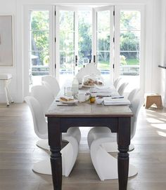 House Beautiful ...great dining space! Love the contrast btwn the modern chairs & farm table.