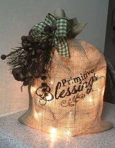 Burlap bag with lights Christmas Bulbs, Christmas Decorations, Holiday Decor, Burlap Bags, Bunkhouse, Primitive Decor, Primitives, Blessed, Creativity